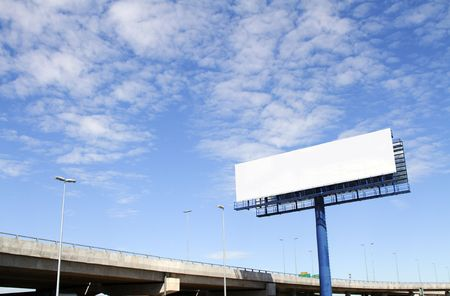 blank billboard: A blank billboard with an elevated highway in the background Stock Photo