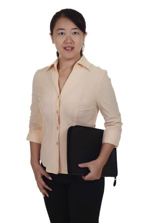 An Asian business executive holding an organizer and isolated in white background Stock Photo - 7622386