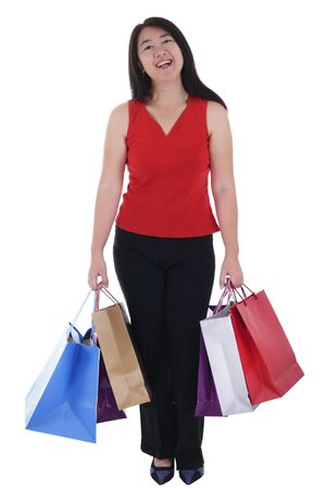 An Asian woman holding multiple shopping bags isolated in white background