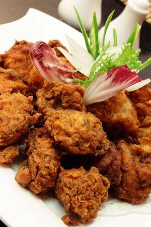 garnishing: Crispy fried chicken served with garnishing.