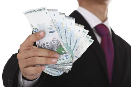 An Asian businessman holding some Malaysian currency.