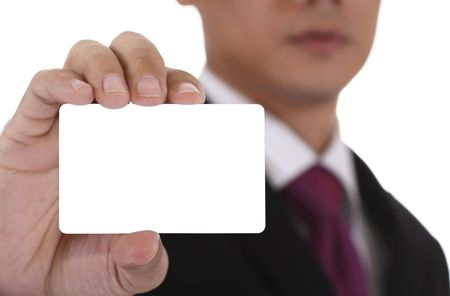 business card in hand: An Asian businessman displaying a blank business card.