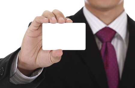 displaying: An Asian businessman displaying a blank card.