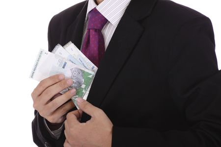 A businessman pulling some cash out of his jacket Stock Photo