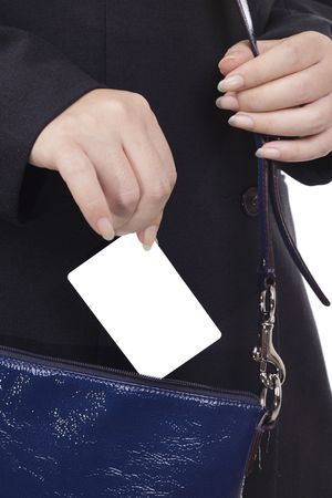 A businesswoman pulling out a blank credit card out of her handbag. Stock Photo - 7672756