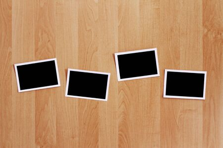A row of blank photos stuck on a wooden wall.  Stock Photo - 7802069