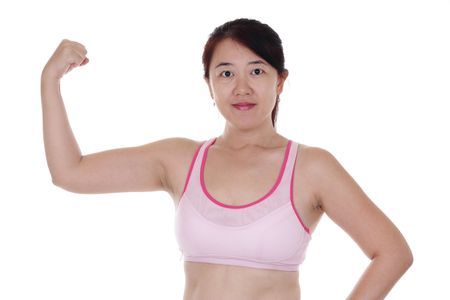 tricep: An Asian woman flexing her muscles Stock Photo