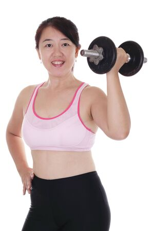 An Asian woman working out with a dumbbell photo