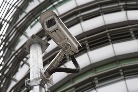 A security camera in front of an office block Stock Photo - 8145294