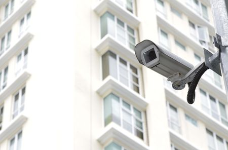 A security camera in front of an apartment block