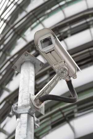 A security camera in front of an office block Stock Photo