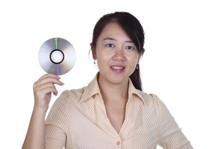 An Asian woman holding a DVD Stock Photo - 8213470