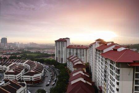An urban landscape in Malaysia with an apartment block in the foreground Stock Photo