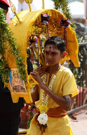 Batu Caves, MALAYSIA - JANUARY 19:A young Kavadi carrier during the Hindu festival of Thaipusam.