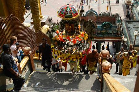 kavadi: Batu Caves, MALAYSIA - JANUARY 19:A man carries a Kavadi during the Hindu festival of Thaipusam.
