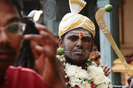 kavadi: Batu Caves, MALAYSIA - JANUARY 19:A man taking trance during the Hindu festival of Thaipusam.