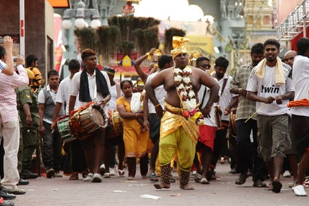 Batu Caves, MALAYSIA - JANUARY 19:A man in trance walks ahead of a Kavadi procession during the Hindu festival of Thaipusam.