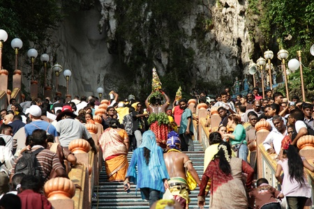 BATU CAVES, MALAYSIA - JANUARY 20: The crowd on the stairs leading up to a temple during the Hindu festival of Thaipusam on January 20, 2011 in Batu Caves, Malaysia.