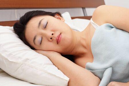 An Asian woman sleeping at home Stock Photo