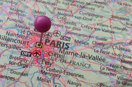 map pin: Location of Paris on a map with a pin Stock Photo