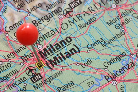 Close up of a pin on Milano or Milan on an atlas