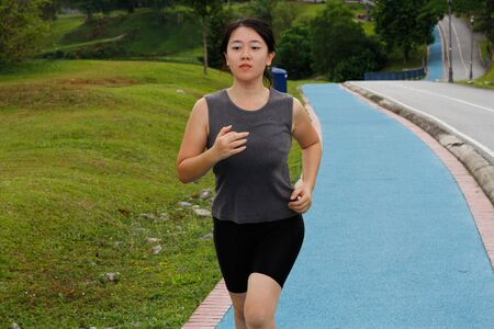 A woman jogging at a park Stock Photo - 9148479