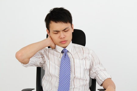 An office worker suffering from neck ache photo