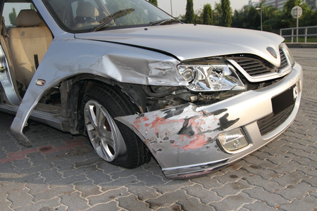 totaled: An abandoned wrecked car at a parking lot Stock Photo