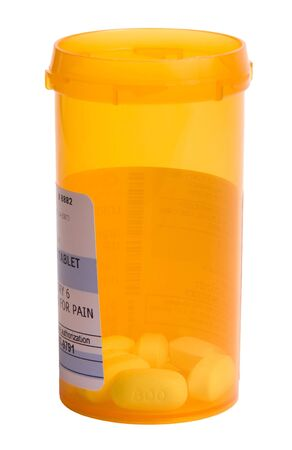 Bottle of pain medicine on white background with focus on PAIN Stock Photo