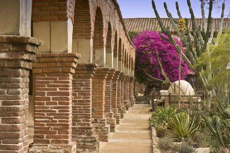 Church columns and walkway at Mission San Juan Capistrano