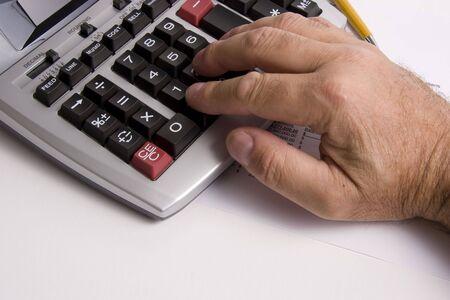 Using a ten key calculator Stock Photo