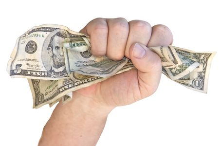 Money clenched in fist isolated on a white background