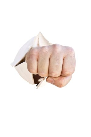 Mans closed fist punching through a wall in anger Stock Photo