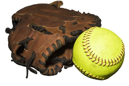 hardball: Catchers glove with loose yellow softball isolated on a white background