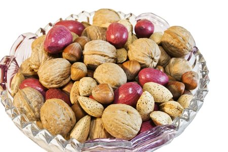 Bowl full of mixed nuts for the holidays isolated on a white background