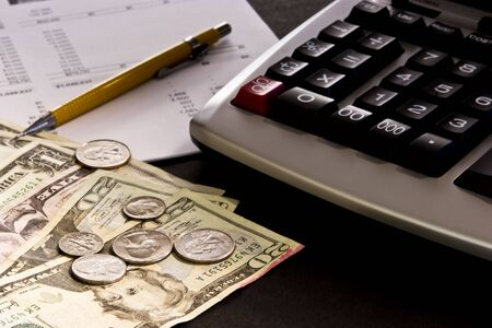 Paper currency with adding machine, financial statement and yellow pencil Stock Photo