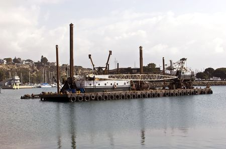 Dredging machine achored in the harbor