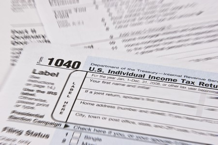 U.S. Income Tax Form with focus around 1040 Individual Income Tax Return