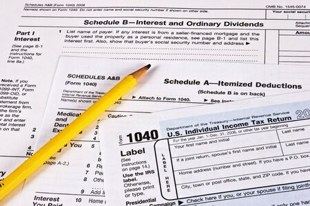 U.S. Income Tax Return with schedules A and B and a pencil to complete the forms