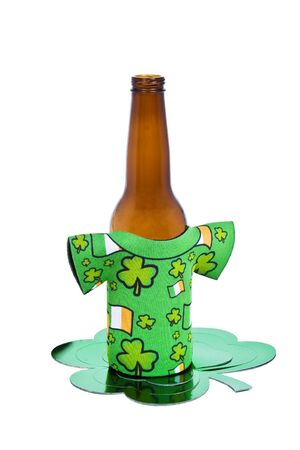 A beer bottle with a Saint Patricks Day sleeve on it