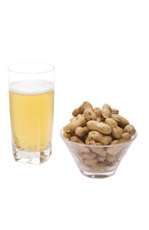 Glass of beer and bowl of peanuts isolated on white
