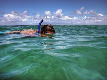 Snorkeler at Tunnels Beach in Kauai, Hawaii
