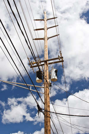Traditional above ground high voltage pole and lines with transformer boxes