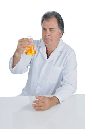 Lab Technician examining a beaker of liquid chemicals
