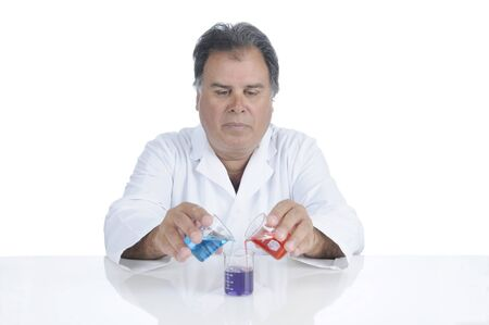 Lab techinician mixing chemicals during an experiment Stock Photo