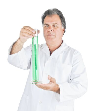 Lab Technician examining a tube of liquid chemicals Stock Photo