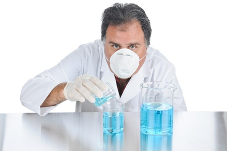 Lab technician mixing chemicals during an experiment