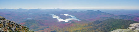 Hazy panoramic view of Lake Placid during the autumn.