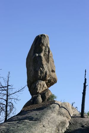 burned out: Balanced rock amid burned out forest on a mountain side adjacent to the Catalina Highway in Coronado National Forest north of Tucson Arizona Stock Photo