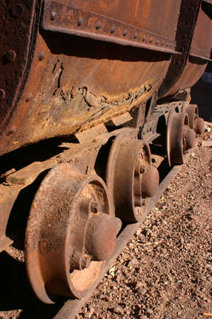 rusting: Rusting wheels on an antique mining cars on rails in Tombstone Arizona